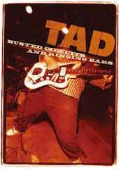 TAD took the idea of playing LIVE very seriously; it was a life or death matter. This DVD not only stands as testimony to that claim, but it's also a cinematic document of the world's HEAVIEST band EVER (as Bruce Pavitt so incisively puts it) bodily stretching that assertion beyond any previously known limitations. Better than a tattoo, it's an open scar that roars, a broken alarm bell ringing from the lost event horizon of a long-dead star, one we could never see--that is, until this DVD clipped it back onto the light box of the silver screen, where it can be deciphered and viewed anew. This documentary telescopes the musical pathology of TAD down into the image of an electrocardiograph recording the minor-mode melody of a final infarct, a demented soundtrack that is neither tame nor de-clawed. It was never meant to be. Dare to feel it, and, like me, risk bleeding internally. - TAD - Busted Circuits and Ringing Ears
